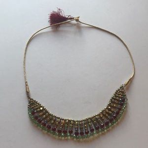 Noonday gold corded necklace red green clear beads